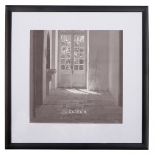 Un pan de mur avec des cadres photos  Un pan de mur avec des cadres photos  Un pan de mur avec des cadres photos