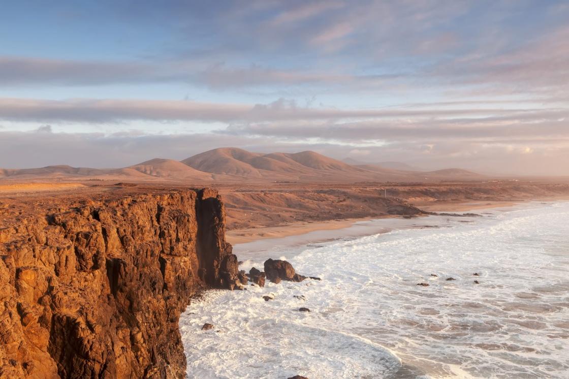 sand-between-your-toes-fuerteventura-beaches-el-cotillo-beach-in-fuerteventura-island-on-sunset-663-5a28